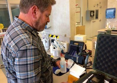 Colorado Springs Utilities' Corey Thiel readies his field equipment in the lab at a water treatment facility in Colorado Springs. Credit: Holly Pretsky