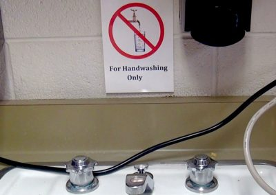 A sign warns students at Lakewood's Stober Elementary School not to use the water from a sink that hasn't been tested for led. Photo by Shelley Schlender.
