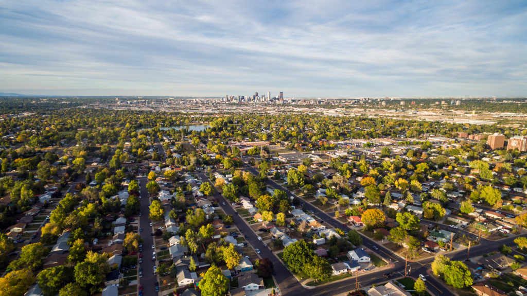 Aerial view of residential neighborhood in Aurora, CO with view of downtown Denver.