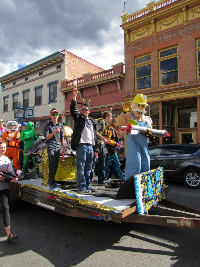 A homecoming parade underway in Idaho Springs on Oct. 5. The community is among 40 on a statewide monitoring list for possible lead contamination and other issues.