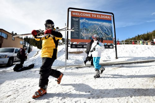 Jonathan Epstein and his daughter Carlie, 12, walk back to their cars after skiing at Eldora Mountain Resort on Sunday in Boulder County. Eldora lies within the South Platte Basin, which has one of the best snowpacks in the state right now. Photo by Jeremy Papasso