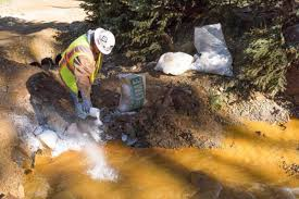 A worker at a clean-up site for the Gold King Mine Disaster in Colorado.