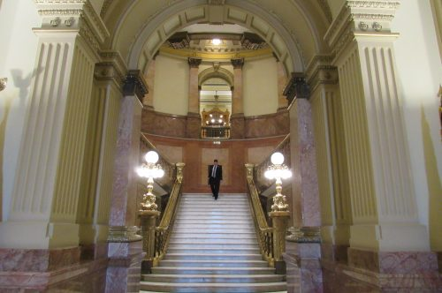 A man descends the main staircase at the Colorado State Capitol at the end of the work day on Feb. 19, 2019. Credit: Jerd Smith