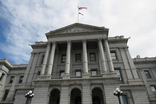 An American flag flies above the Colorado State Capitol. Credit: Jerd Smith