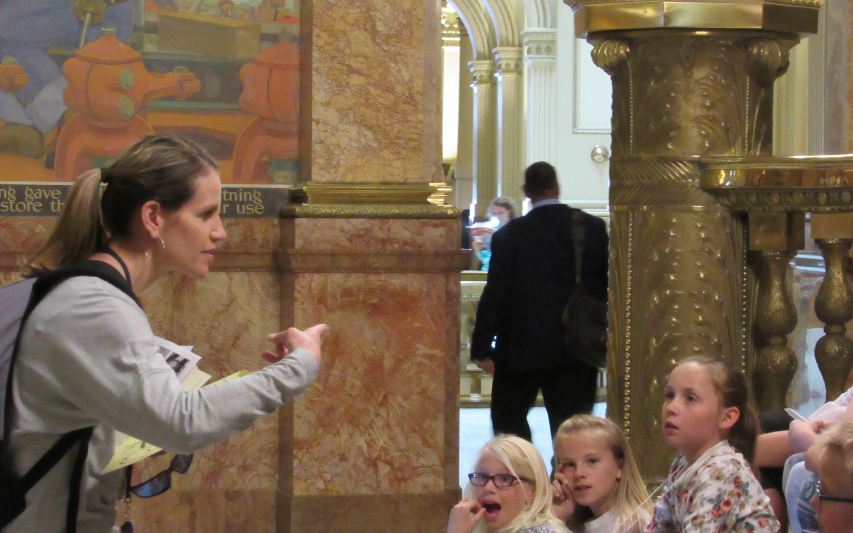 Trout Core Knowledge Teacher Courtney Petros discusses the work of Colorado lawmakers with her fourth grade students on May 3, the last day of the session. The Fort Collins school brings students to the legislature each year on closing day. Credit: Jerd Smith