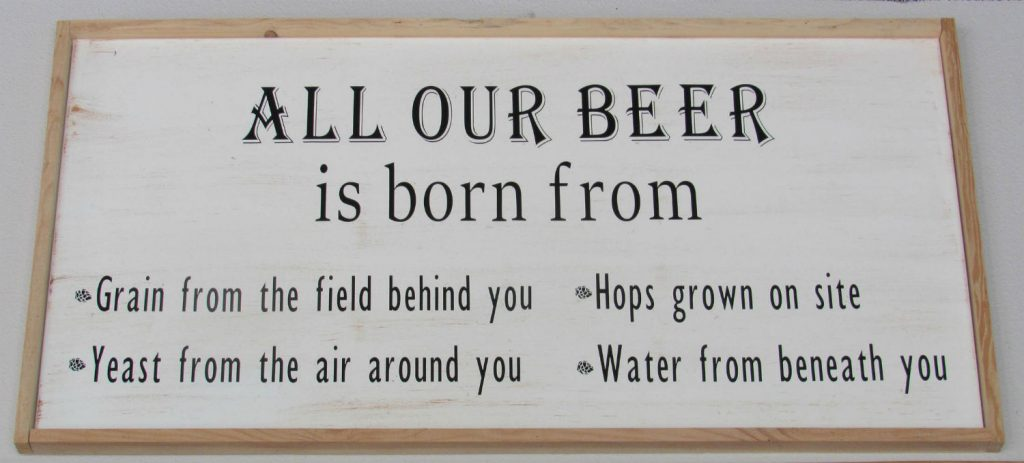 A sign at the Colorado Farm Brewery pays homage to the farm. June 7, 2019. Credit: Jerd Smith