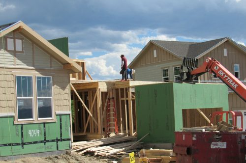 Construction workers build a single family home in Castle Rock. The needs new surface water supplies to reduce its reliance on non-renewable groundwater. Credit: Jerd Smith