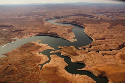 "Lake Powell, created with the 1963 completion of Glen Canyon Dam, is the upper basin's largest reservoir on the Colorado River. But 2000-2019 has provided the least amount of inflow into the reservoir, making it the lowest 20-year period since the dam was built, as evidenced by the ""bathtub ring"" and dry land edging the reservoir, which was underwater in the past. As of October 1, 2019, Powell was 55 percent full. Credit: EcoFlight"