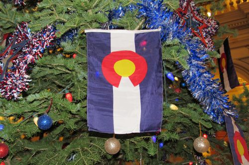 A holiday tree is adorned with the Colorado State flag at the State Capitol. Dec. 10, 2019. Credit: Jerd Smith