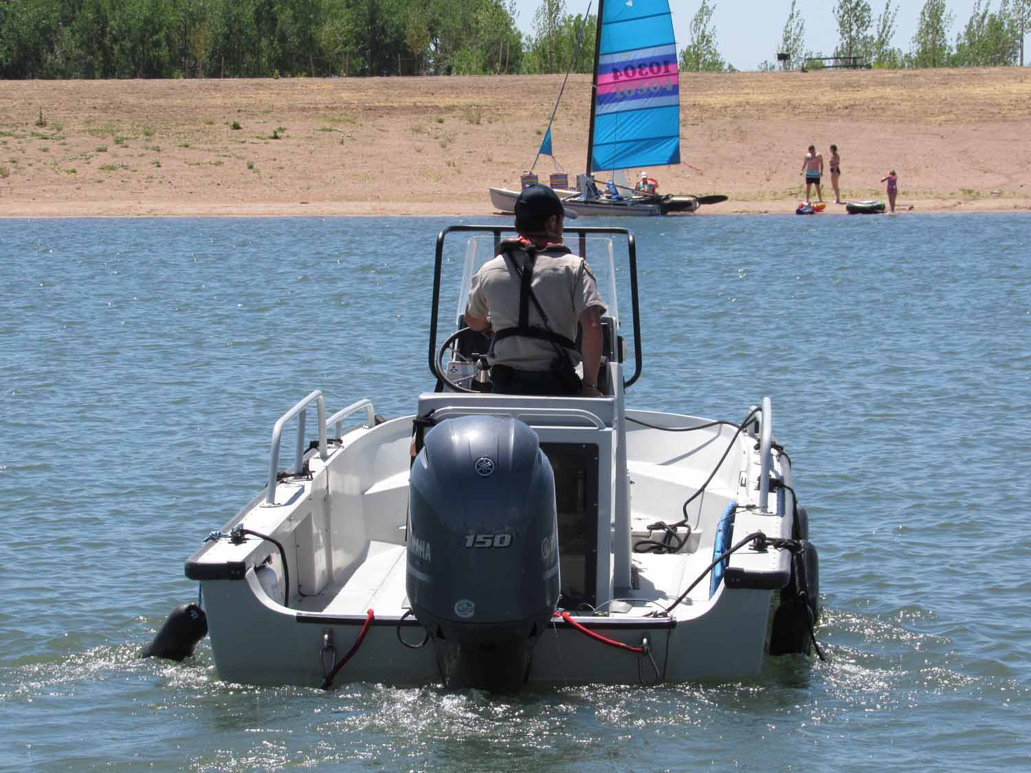 A Colorado Parks and Wildlife officer heads out on patrol at Chatfield Reservoir. A $171 million redesign at the popular lake is now complete, providing more water storage for Front Range cities and farmers. But environmental concerns remain about the project's impact on hundreds of bird species. June 8, 2020 Credit: Jerd Smith