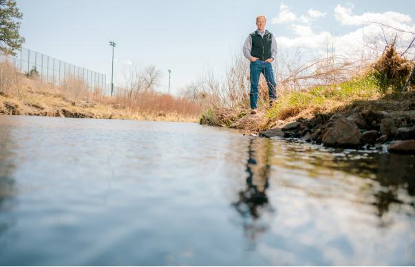 Leon Basdekas stands beside Monument Creek in Colorado Springs, Colorado.